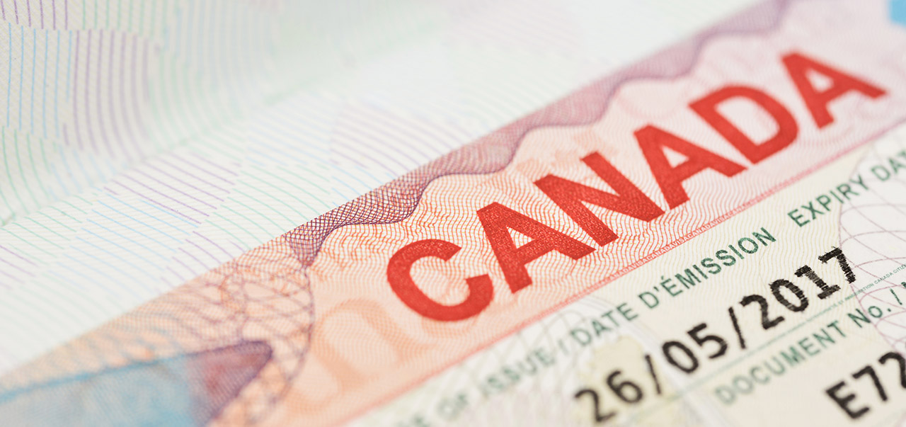 Macro view of a Canadian visa on thailand passport.